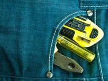 Blue jeans e strumenti Immagini Stock