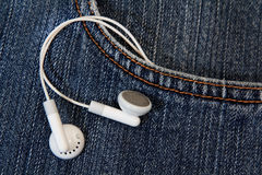 Blue jeans with earbud from its pocket Royalty Free Stock Image