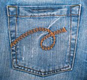 Blue jeans fabric with pocket as background Stock Images