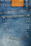 Blue jeans fabric with pocket and label Royalty Free Stock Photos