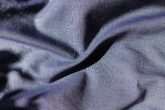 Blue jeans fabric shot with violet in folds. Blue jeans fabric shot with violet in soft folds Stock Photo