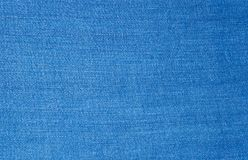 Blue jeans fabric textile. Close up texture background royalty free stock images