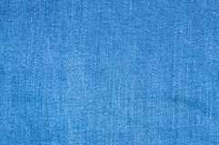 Blue jeans fabric textile. Close up texture background royalty free stock photography