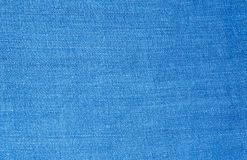 Blue jeans fabric textile. Close up texture background stock photography