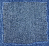 Blue jeans fabric texture with frame Royalty Free Stock Photography