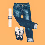 Blue jeans, fashion shoes and accessories Stock Images