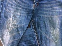Blue jeans folded one leg on black background. stock photo