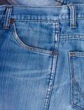 Blue Jeans-Gewebe mit Taschenhintergrund Stockbild
