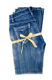 Blue jeans and gold ribbon isolated on white background Royalty Free Stock Photo