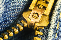 Blue jeans, gold zipper fly, macro image. Royalty Free Stock Photography
