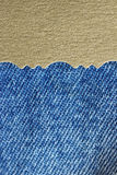 Blue jeans and golden paper texture Royalty Free Stock Photo