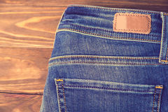 Blue jeans with half of back pocket and brown leather tag Stock Images