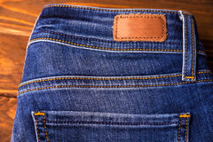 Blue jeans with half of back pocket and brown leather tag Royalty Free Stock Photo