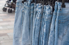 blue jeans on hangers at the market Royalty Free Stock Photo