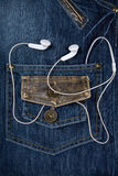 Blue jeans and headphones Royalty Free Stock Photos