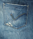 Blue jeans with hole in a pocket Royalty Free Stock Photos