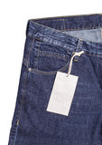 Blue Jeans With Label On White Background Stock Photos