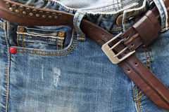 Blue jeans with leather belt Stock Photos