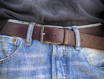 Blue jeans with leather belt Royalty Free Stock Photo