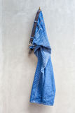 Blue jeans with leather belt is hanging on hanger with exposed c Stock Photography