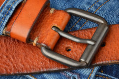 Blue jeans with leather belt Royalty Free Stock Images