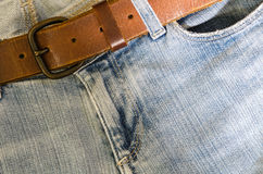 Blue jeans and leather belt royalty free stock photography