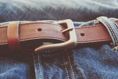 Blue jeans with a leather belt in vintage color Royalty Free Stock Photo