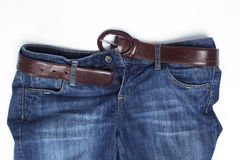 Blue jeans with leather belt Royalty Free Stock Photography
