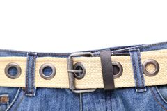 Blue jeans and leather white belt Royalty Free Stock Photography