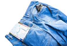 Blue jeans with a letter and camera in the pockets Stock Photos