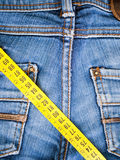 Blue jeans and measure tape Stock Image
