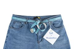 Blue jeans with measure tape with paper note. Exercise and diet concept. Royalty Free Stock Photo