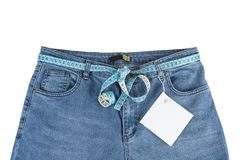 Blue jeans with measure tape with paper note. Exercise and diet concept. Royalty Free Stock Photography