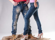 Blue jeans for men and women royalty free stock image