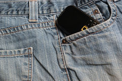 Blue Jeans and mobile phone Royalty Free Stock Photo