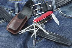 Blue jeans with multifunction penknife Stock Photo