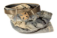 Blue jeans with old black leather strap Royalty Free Stock Images