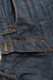 Blue jeans with old brown belt Stock Images