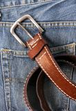 Blue jeans with old brown belt Stock Photography