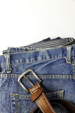Blue jeans with old brown belt Stock Photo