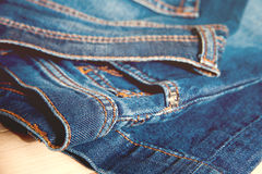 Blue jeans on old wooden background. Stock Photography
