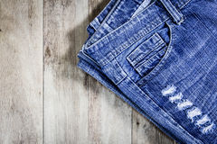 Blue jeans on old wooden surface Stock Images
