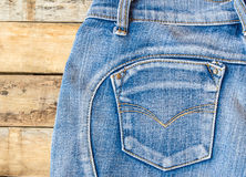 Blue jeans on old wooden surface Royalty Free Stock Images