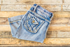 Blue jeans on old wooden surface Stock Image