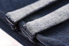 Blue jeans piegate orlate Immagini Stock