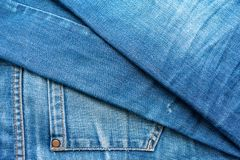 Blue jeans pile. Denim Texture stock photos