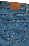 Blue Jeans Pocket Closeup. Blue jeans fabric with back pocket and a leather label stock photos