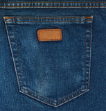 Blue Jeans Pocket Closeup. Blue jeans fabric with back pocket and a leather label stock photo