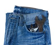 Blue jeans pocket with old tool Stock Image
