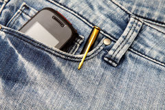 Blue jeans pocket with phone and pen Stock Images